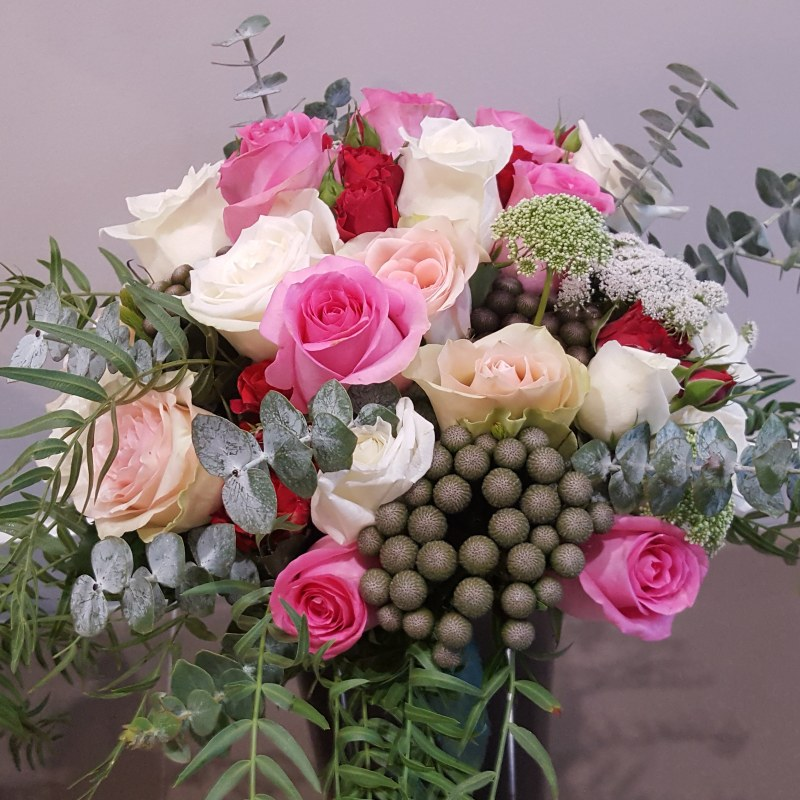 Bridal Bouquet with pinks, white and a hint of red with different textured greenery.