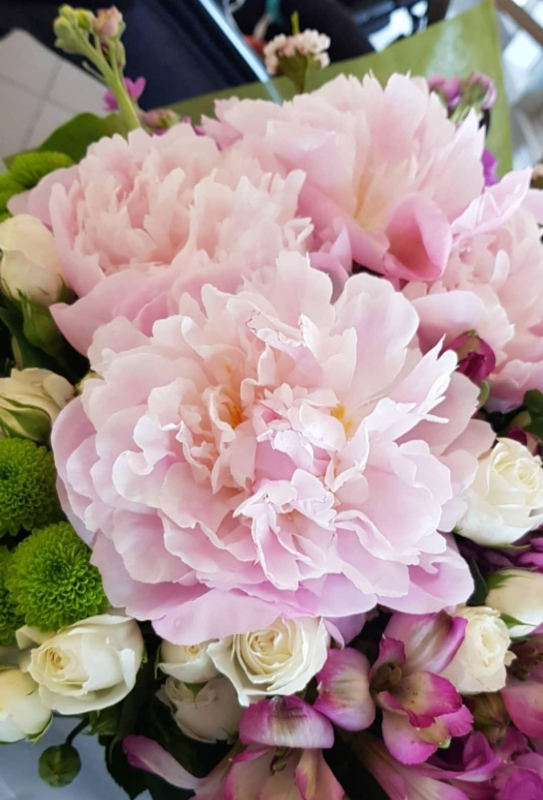 Bridal Bouquet with seasonal Spring flowers including Peonies